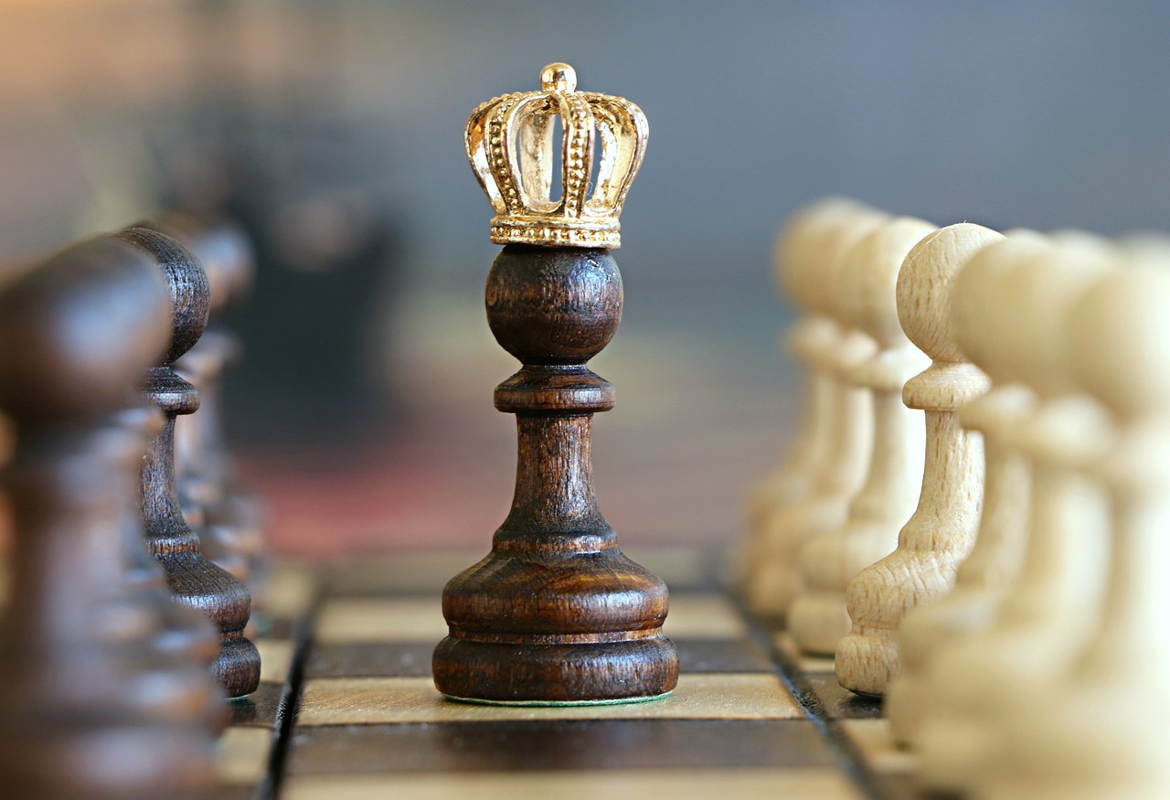 chess pawn with gold crown
