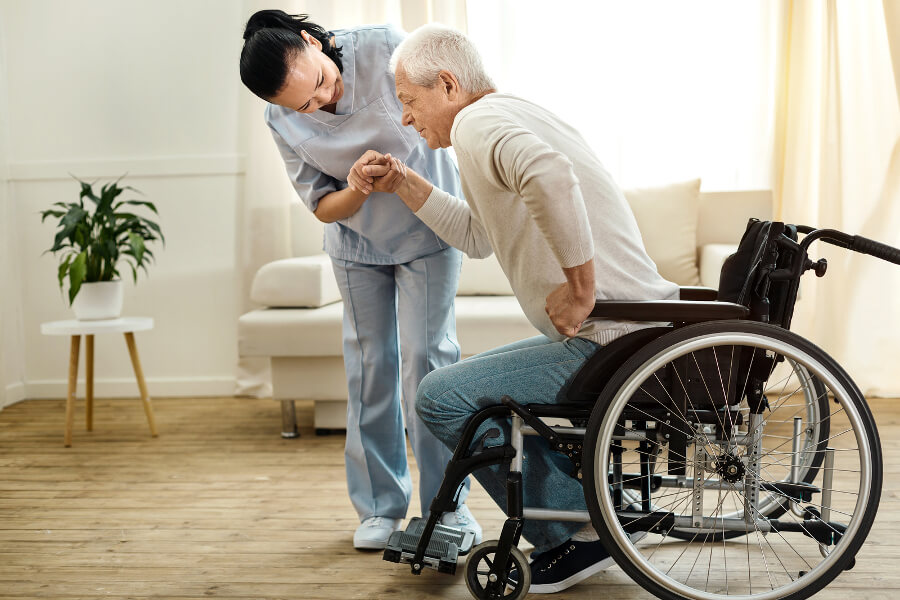 Healthcare-helping-disabled-man
