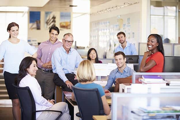 Businesspeople Having Meeting In Modern Open Plan Office