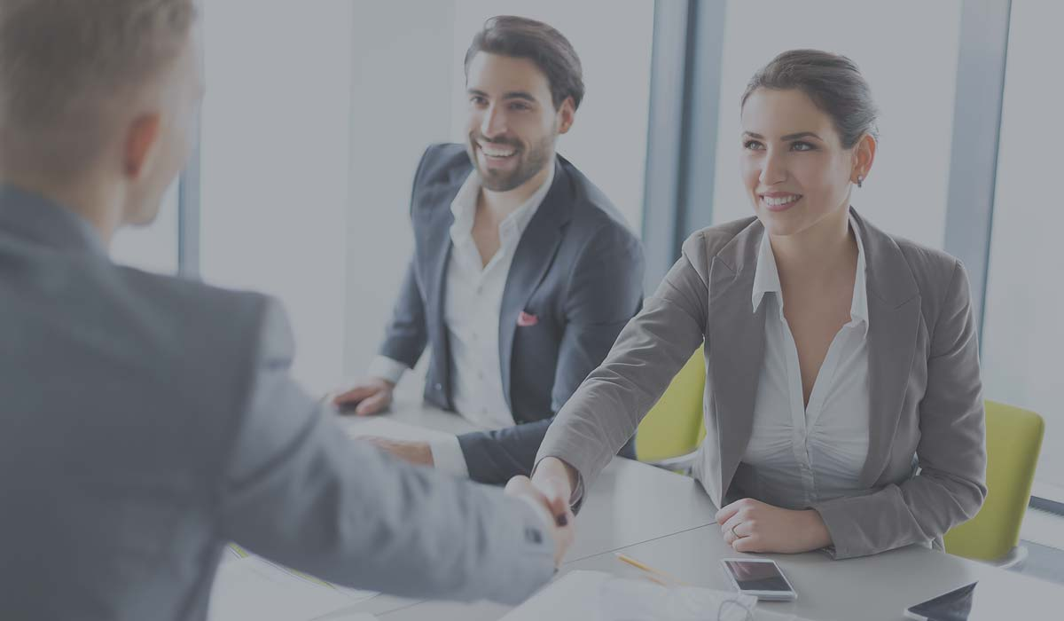 New hire recruit shaking hands with interviewer