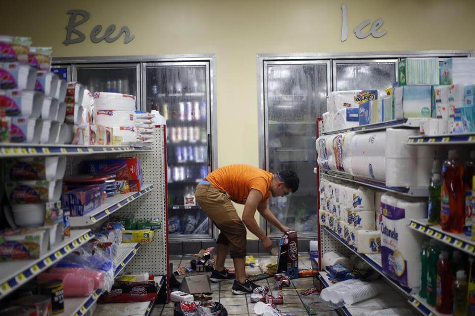 Cleaning up at a Houston gas station on Wednesday, after Harvey's rains moved on. (Photo by Luke Sharrett/Bloomberg)