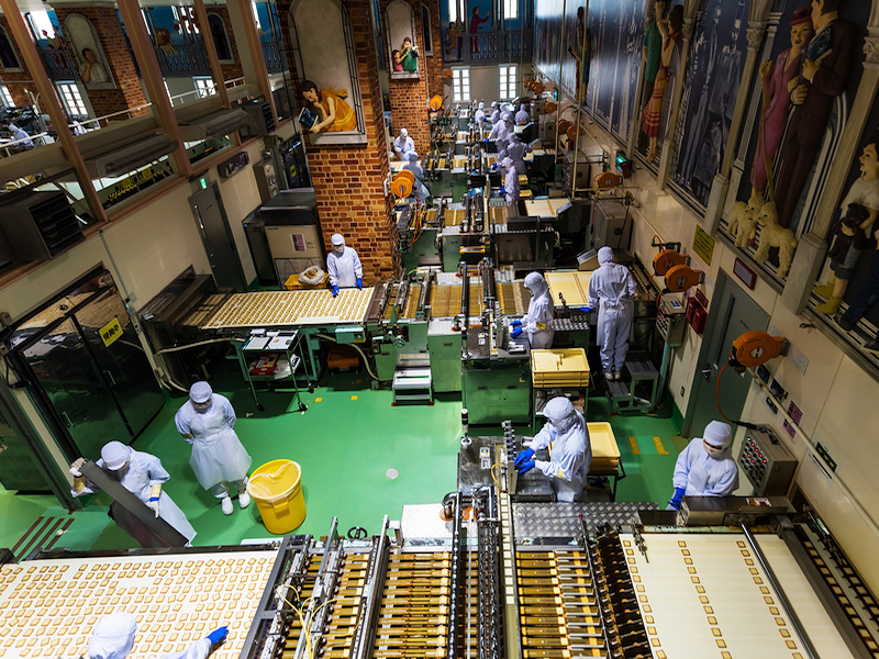 """SAPPORO JAPAN -APRIL 25 2016: Unidentified baker produce chocolate product inside Chocolate factory """"Shiroi Koibito"""" buildiing by Ishiya a local chocolate company."""