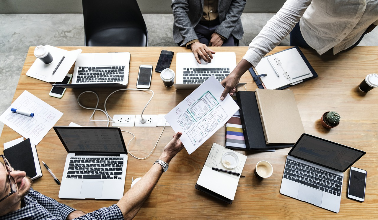 coworkers collaborating at meeting table