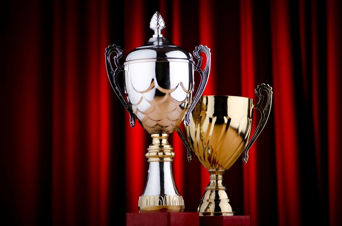 2 trophies on pedestal